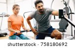 personal trainer assisting... | Shutterstock . vector #758180692
