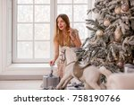 beautiful blonde girl in a gold ... | Shutterstock . vector #758190766