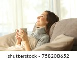 woman relaxing holding a coffee ... | Shutterstock . vector #758208652