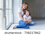 young mother holding her child. ... | Shutterstock . vector #758217862
