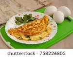 omelette in french and eggs.... | Shutterstock . vector #758226802