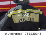rescuer in uniform with the... | Shutterstock . vector #758230345