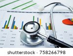 stethoscope  charts and graphs... | Shutterstock . vector #758266798