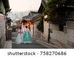 back of two women wearing... | Shutterstock . vector #758270686