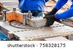 construction workers using... | Shutterstock . vector #758328175