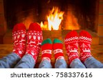 family in christmas socks near... | Shutterstock . vector #758337616