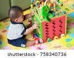 thai boy 6 months old is... | Shutterstock . vector #758340736