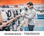 smart young customer chooses a... | Shutterstock . vector #758350435