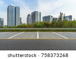 empty car park with downtown... | Shutterstock . vector #758373268