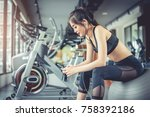 asian woman sitting on fitness... | Shutterstock . vector #758392186