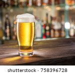 frosty glass of light beer on...   Shutterstock . vector #758396728