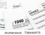 tax forms 1040. close up. | Shutterstock . vector #758446975