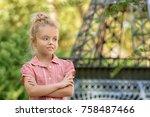 little fashionable girl outdoors | Shutterstock . vector #758487466