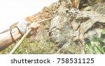 woman climbing a rock wall in a ...   Shutterstock . vector #758531125