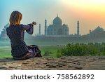 beautiful girl points to taj... | Shutterstock . vector #758562892