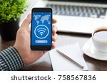 man holding phone with...   Shutterstock . vector #758567836