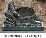 """Small photo of Bronze bas-relief dedicated to first russian icebreaker """"Yermak"""". The text on the bas-relief says """"Yermak in polar ice"""""""