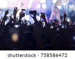 hand with a smartphone records... | Shutterstock . vector #758586472