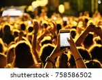 hand with a smartphone records... | Shutterstock . vector #758586502