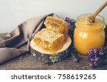 honeycombs and glass pot with... | Shutterstock . vector #758619265