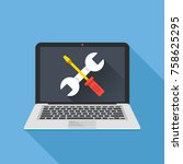laptop with wrench and... | Shutterstock .eps vector #758625295