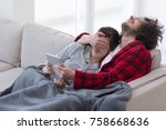 young couple relaxing at  home... | Shutterstock . vector #758668636