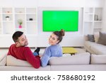 young couple on the sofa... | Shutterstock . vector #758680192
