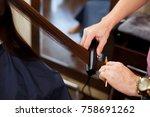 man stylist align the customer... | Shutterstock . vector #758691262