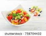 bowl of fresh fruit salad on... | Shutterstock . vector #758704432