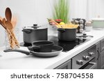 cooking utensils on electric... | Shutterstock . vector #758704558