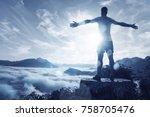 man on a summit over an ocean... | Shutterstock . vector #758705476