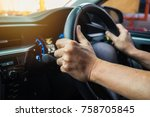 male driving car on day time ... | Shutterstock . vector #758705845