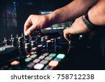 dj mixes the track in nightclub ... | Shutterstock . vector #758712238