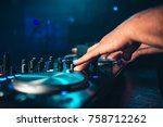 dj controls and mix music on... | Shutterstock . vector #758712262