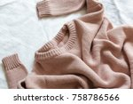 pink knitted sweater lies on... | Shutterstock . vector #758786566