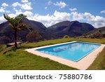 Swimming pool against mountain range - stock photo