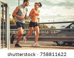 couple of runners jogging on...   Shutterstock . vector #758811622