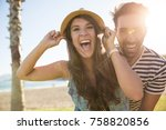 happy couple on beach laughing... | Shutterstock . vector #758820856