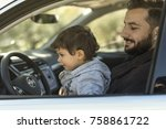 father and son in car playing... | Shutterstock . vector #758861722