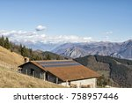 mountain lodge with solar panels | Shutterstock . vector #758957446