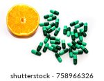 an orange and pills together. | Shutterstock . vector #758966326