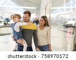 happy family with child doing... | Shutterstock . vector #758970172