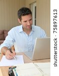 smiling man working at home on... | Shutterstock . vector #75897613