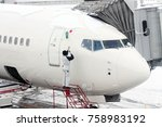 snow removal from airplane | Shutterstock . vector #758983192