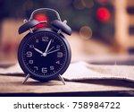 old black vintage alarm clock... | Shutterstock . vector #758984722