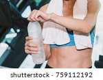 sporty woman holdind water... | Shutterstock . vector #759112192