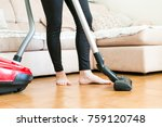 young woman using a vacuum... | Shutterstock . vector #759120748