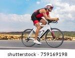 triathlon cyclist man cycling... | Shutterstock . vector #759169198