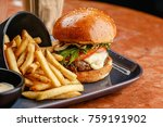 burger with beef and cheese on... | Shutterstock . vector #759191902