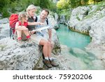 Trekking - family on mountain trek - stock photo